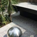 Steel sculptural ball in hard landscaping